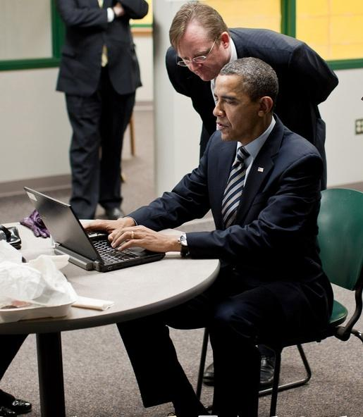 Former White House Press Secretary Robert Gibbs, shown here with President Obama, reportedly won't be joining Facebook, which had reportedly offered him millions.