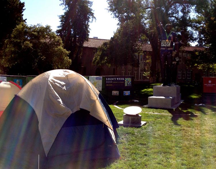 """Students begin setting up for a """"sleep out"""" to garner support for San Jose's Measure D proposed minimum wage increase from $8 to $10 an hour."""
