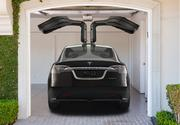 """Tesla's Model X SUV will come with gull wing doors that open upwards. The company is calling these """"falcon wings."""""""