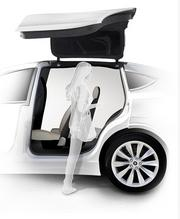 The second seat of the Tesla Model X slides forward to make it easier for passengers to enter and exit the third row.