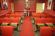 The theater room features actual theater seating repurposed from The Retro Dome, which closed its doors in January.Quixey uses the theater room for developer meetings, and has taken to starting meetings by screening trailers for upcoming films.