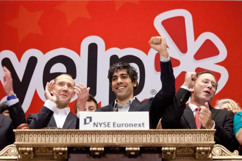 Yelp CEO Jeremy Stoppelman along with members of the company's management team and employees from its New York office ring the opening bell to celebrate Yelp's IPO and first day of trading on the NYSE.