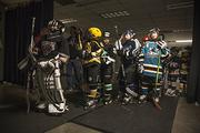 Kids line up behind the scenes before heading out to the ice for the Sharks' opening ceremony.