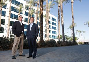 Steve Dunn, senior managing director at Legacy Partners, left, and Derrick How, vice president of acquisitions and development, helped transform a former dump site into a green office project, shown here.