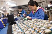Workers assemble circuit boards at the GEA facility. GEA added about 12 people for the ET Water contract.
