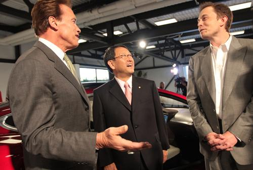 In May 2010, California Gov. Arnold Schwarzenegger, from left, Toyota Motor Corp. President Akio Toyoda and Tesla Motors Inc. CEO Elon Musk cement a deal that reopens the NUMMI plant for vehicle manufacturing, and forms a partnership between the two automakers.