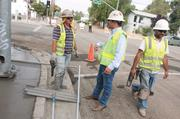 On the job: From left, Miguel Sandoval, and Kevin Albanese on a project in downtown San Jose.