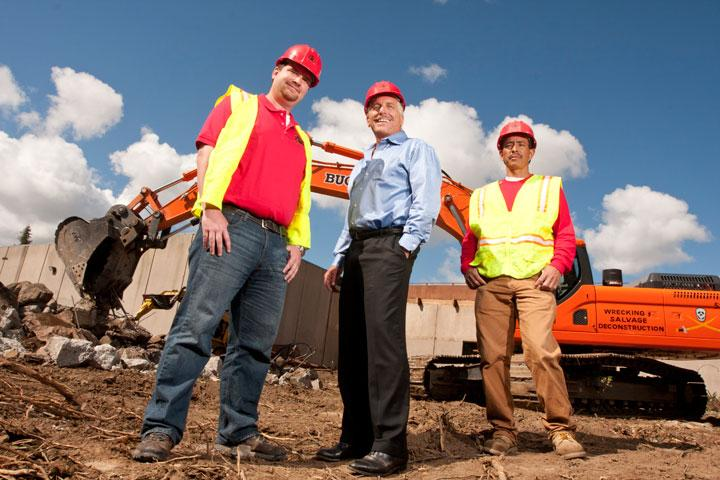 From left, Division Manager Arturo Ramirez, President Jim Salata, and Foreman Javier Ramirez recycle and reuse up to 95 percent of the materials in a Buccaneer Demolition project.