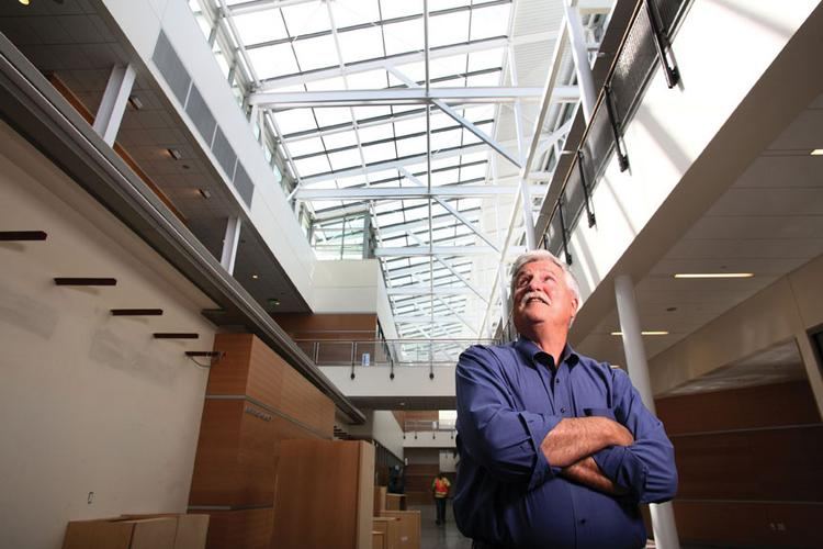 De Anza College President Brian Murphy checks out the progress inside the school's new Media and Learning Center in Cupertino. The building uses a buoyancy-driven air circulation system.