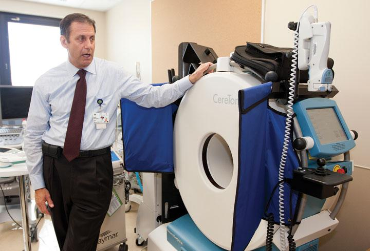 Good Samaritan CEO Paul Beaupre shows off the Portable CT scanner at the hospital's new Nuerology Intensive Care Unit.