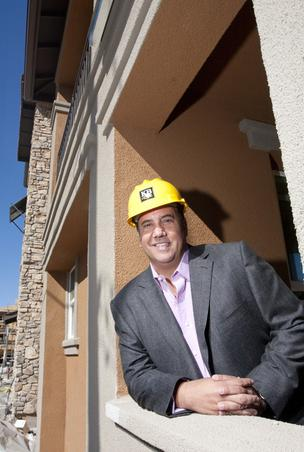 Chris Apostolopoulos, president of KB Home Northern California, said his company is moving forward on one of the largest undeveloped parcels left in San Jose. Here he is at his company's Vicino project near Santana Row.