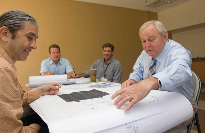 John P. Traub, president and CEO of Nanolab Technologies (right), looks at blueprints for a remodel planned at the company's new site on McCarthy Blvd.  The remodel team includes (from left): Alexander Petrovic, project manager with Acies Engineering; James R. Fulton of Arc Tec; and Scott Zavack with Globalscope.