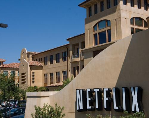 Netflix stock hit 52-week lows, continuing a new sell-off after the company said it would split off its DVD rental business under the new name of Qwikster.
