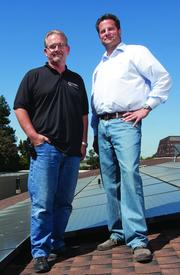 Ron Vincent, VP of field operations, and CEO Jim Petersen put solar systems on about 50 percent of the roofs PetersenDean installs.