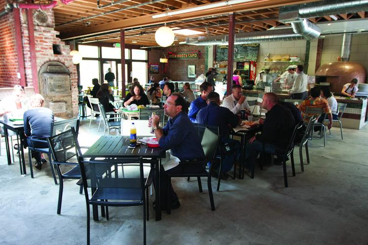 Lunch-hour attraction: San Pedro Market Square is gaining momentum among customers and small businesses alike. The market is nearly fully leased and drawing more customers, according to operators.
