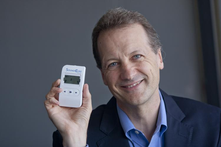 Hearing help: Bill Perry, CEO of SoundCure, makes a device that helps alleviate tinnitus, or ringing of the ears. His company recently secured a contract with Veterans Affairs that could potentially impact more than 840,000 U.S. veterans who suffer from tinnitus.