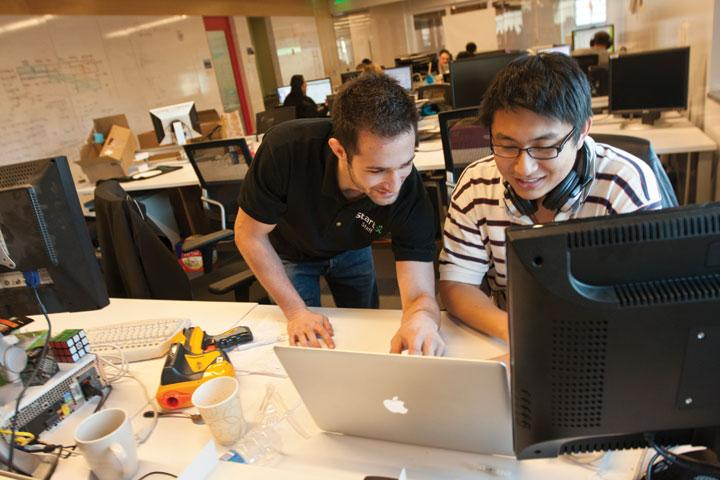 Left, Cameron Teitelman, founder of Stanford's accelerator StartX, works with Yuhao Ding on his stealth startup.
