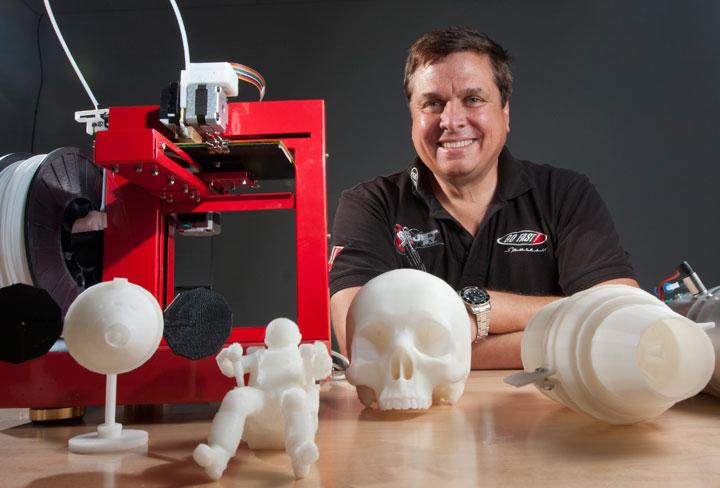 Entrepreneur Andy Filo is using a 3-D printer at TechShop to make pieces for a 1960 jetpack that he is putting together.