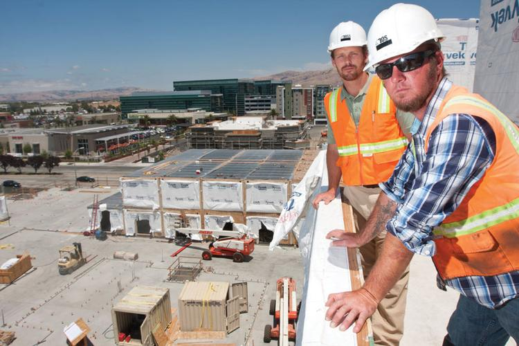Project manager Jason Anderlite, left, and superintendent Jim Hansen oversee the construction site. It takes about 25 days to stack 133 units.