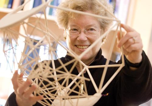 Sandra Faber, professor at UC Santa Cruz, uses telescopes to study phenomena deep in the galaxy. Here she holds a model of the Thirty Meter Telescope, which astronomers are looking to build in Hawaii.
