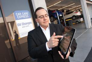 Neil East, CEO of Xtime, demonstrates how his company offers scheduling software to help car makers connect to customers when they have car trouble.
