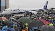 Thousands gather Monday in the rain outside the Boeing Everett plant where the 787 was built to celebrate the delivery of the first Dreamliner to launch customer ANA. Pictured is 787 No. 2 off the line.