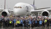 Hundreds of Boeing employees involved in making the 787 walk the Dreamliner to the delivery ceremony of the first Dreamliner to launch customer ANA outside the Boeing Everett plant where the 787 was built.  Pictured is 787 number 24 off the line.