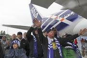 Ken Kemp (center) was one of thousands who gathered in the rain outside the Boeing Everett plant where the 787 was built to celebrate the delivery of the first Dreamliner to launch customer ANA. Pictured is 787 number 24 off the line.  Kemp worked on the interiors of the 787.