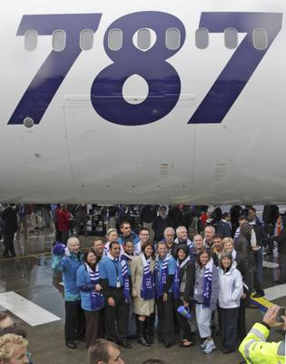 Crowds pose with the 787 just delivered to ANA in the rain outside the Boeing Everett plant where the 787 was built to celebrate the delivery of the first Dreamliner to launch customer ANA.  Pictured is 787 number 24 off the line.