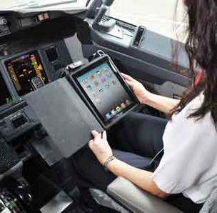 An Alaska Air pilot using the Apple Inc. iPad for work in the cockpit.