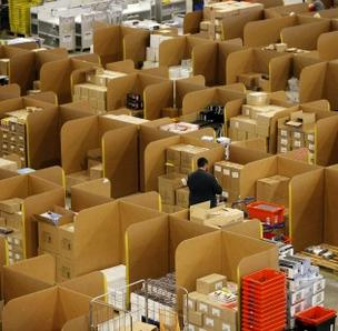Amazon.com posted a fourth-quarter profit thanks to strong holiday sales, but still recorded a loss for the year.