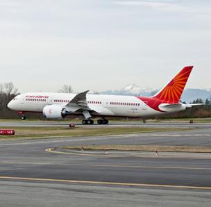 The Indian government is threatening to reject Air India's Boeing 787s unless the U.S. airframer provides compensation for a four-year delay in deliveries.