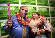 Referendum 74 supporters Jason Lee (left) and Erin Lee of Tacoma have fun while attending Election Night festivities at the Westin Hotel in Seattle.