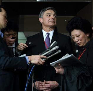 Ray Conner, president and chief executive officer of Boeing Commercial Airplanes, center, attends a news conference following a meeting at the Ministry of Land, Infrastructure, Transport and Tourism in Tokyo, Japan, on Thursday, Feb. 28.