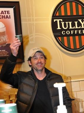 Patrick Dempsey and his investment group Global Baristas earlier handed out coffee at a Tully's Coffee. Today, his investment group Global Baristas won a court challenge to its bid for Tully's.