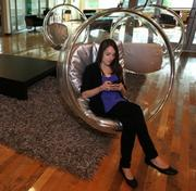 3.           Taking a tour of Google's Seattle spacesGoogle employee Katelin Todhunter-Gerber works on her mobile phone while sitting in an acrylic bubble chair at Google's offices in Kirkland.Google has become one of the largest tech companies in the  region. And it's brought the company's nontraditional  benefit structure, which includes having kayaks in the office in case  you want to take a lunchtime float down the ship canal next to Google's  Fremont office, and a climbing wall if you want to defy gravity at the  Kirkland office.More images here.