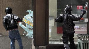10.            Vandals smash windows, banks targeted in downtown Seattle May Day protests      Anarchists smash a window at the Wells Fargo branch on Fourth Avenue  and Seneca Street in downtown Seattle during a May Day protest. Photographer Marcus Donner was on hand to capture the action as protesters turned to violence in downtown Seattle on May 1. More images here.