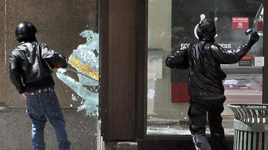 10.            Vandals smash windows, banks targeted in downtown Seattle May Day protests      Anarchists smash a window at the Wells Fargo branch on Fourth Avenue  and Seneca Street in downtown Seattle during a May Day protest. Photographer Marcus Donner was on hand to capture the action as protesters turned to violence in downtown Seattle on May 1.More images here.