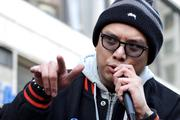 Prometheus Brown of the rap duo Blue Scholars speaks to several hundred Occupy Seattle protesters at a Westlake Park rally before the group marches to the Port of Seattle's Terminal 18.