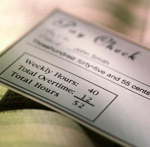 Paychecks will be smaller next year, despite any fiscal cliff deal being made.