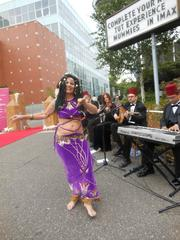 A belly-dancer greets Pacific Science Center guests upon arrival for the Festival of Fountains Golden Gala July 27.  The weather was, in a word, cold, and she was covered in goosebumps.
