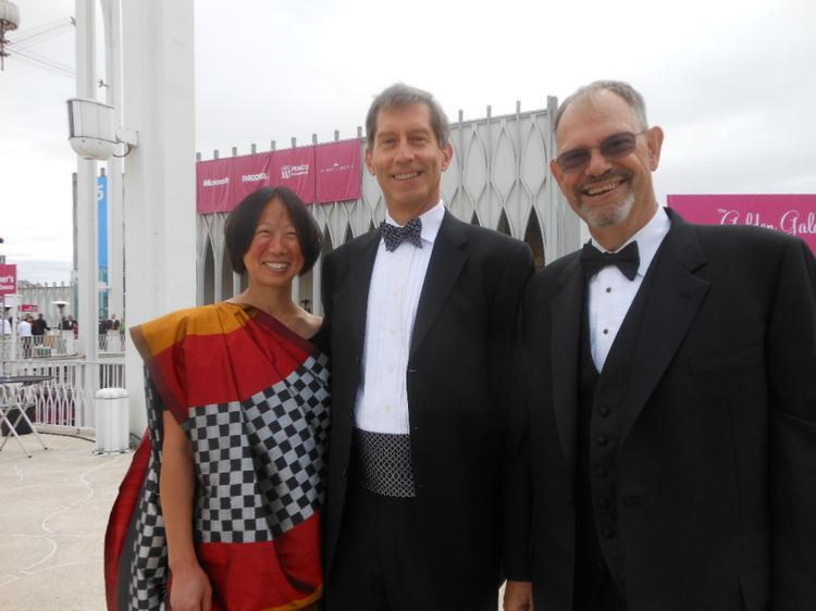 Left to right, Amy Lee, husband Tim Copes, new chair of the board of trustees at Pacific Science Center, and Phil Condit, immediate past chair of Pacific Science Center at PSC's Festival of the Fountains Golden Gala on July 27.