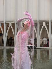 One of several women who acted as living fountains at Pacific Science Center's Festival of the Fountains July 27. The women stood in reflecting pools near outdoor dinner tables, posing while water poured out of their fingers and headdresses.