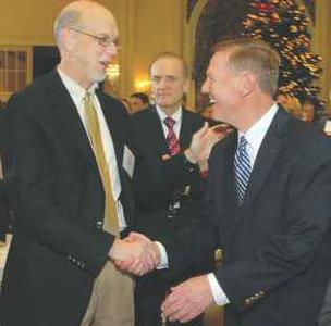 Bob Watt (left) greets Alan Mulally Nov. 22 at the Fairmont Olympic Hotel in downtown Seattle.