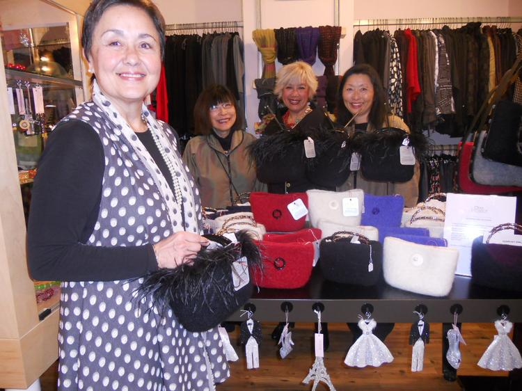 At a recent trunk show at Sandylew boutique in Seattle, Hiyama Studios' founder and president Carole Grisham (left)  stand with Elaine Wetterauer, Sandy Lew Hailer, and Pat Norikane Logerwell, with some of the luxury, hand-made bags from Hiyama's Oba Project.