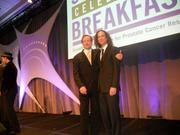 Steve Fleischmann, left, event chair of 2010 Prostate Cancer Survivors Celebration breakfast, poses with friend Kenny G on stage, minutes before the Grammy award winning saxophonist performed for sellout fundraiser.