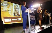 Puget Sound Business Journal Publisher Gordon Prouty (far right) and staff reporter Emily Parkhurst (left) introduce 40 Under 40 honoree Jennifer Olsen of Resourceful HR during the awards ceremony at Showbox Sodo in Seattle on Sept. 20.