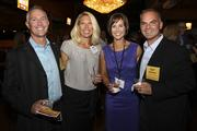 Puget Sound Business Journal 2012 40 Under 40 honorees Jake Domer (left) and his wife, Sue Domer, and fellow honoree Joshua Harris and his wife, Jamie Harris, celebrate at Showbox Sodo in Seattle on Sept. 20.