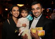 40 Under 40 honoree Raja Mukerji (right) of ExtraHop Networks and his wife Lipika Mukerji and daughter celebrate at the awards bash at Showbox Sodo in Seattle on Sept. 20, 2012.