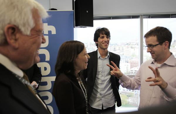 Clockwise from left: Rep. Jim McDermott and Sen. Maria Cantwell chat with Facebook Seattle software engineer Ari Steinberg and Facebook's Vice President of Engineering Mike Schroepfer during the opening of Facebook's new downtown Seattle offices.